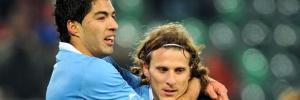 Vos avatars Forlan-d-e-suarez-deixaram-sua-marca-na-vitoria-por-3-a-1-dos-uruguaios-sobre-a-suica-1267654387857_300x100