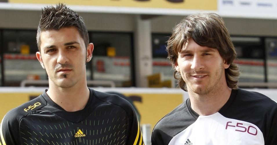 David Villa e Lionel Messi participam do evento de lançamento das chuteiras que usarão na Copa