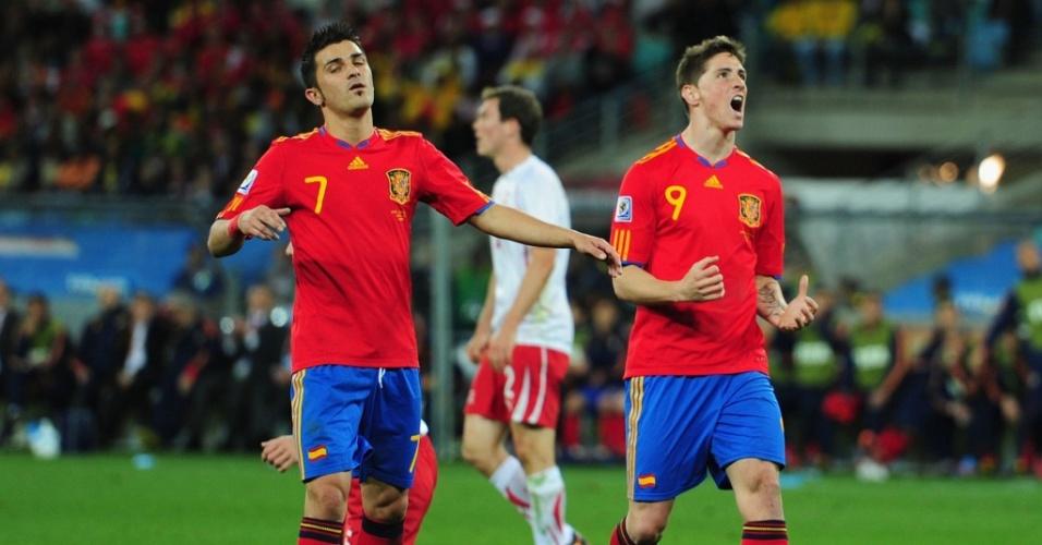 Fernando Torres e Xavi lamentam a derrota da espanha para a Suíça